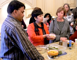 Chefs Hemant Mathur and Surbhi Sahni (in red) demonstrate the recipe.