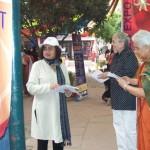 Nalini Saligram hands out materials